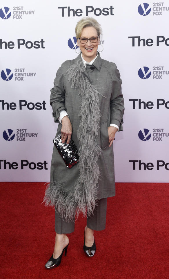 <p>Meryl showed off her sartorial prowess in a feathered grey Prada suit and patent Nina Ricci heels. <i>[Photo: Getty]</i> </p>