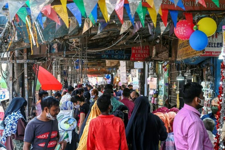 Crowds shop at a market in New Delhi after lockdown curbs are eased