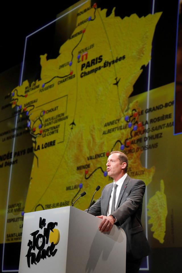Tour de France director Christian Prudhomme speaks in front of the map of the itinerary of the 2018 Tour de France cycling race during a news conference in Paris, France, October 17, 2017. The world's greatest cycling event will start from Noirmoutier-en-L'Ile on July 7 and will finish at the Champs Elysees in Paris on July 29. REUTERS/Charles Platiau