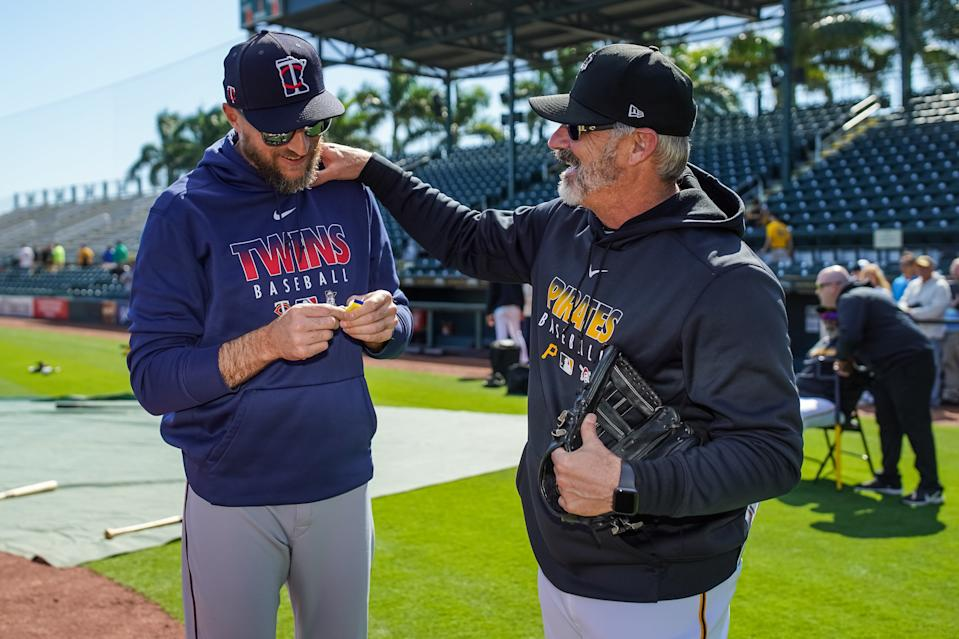BRADENTON, FL- FEBRUARY 22: Manager Rocco Baldelli #5 of the Minnesota Twins talks with manager Derek Shelton #17 of the Pittsburgh Pirates prior to a spring training game on February 21, 2020 at LECOM Park in Bradenton, Florida. (Photo by Brace Hemmelgarn/Minnesota Twins/Getty Images)