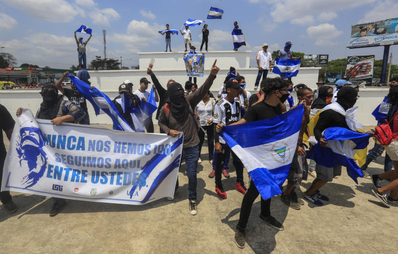 Anti-government protesters join a Stations of the Cross procession on Good Friday, in Managua, Nicaragua, Friday, April 19, 2019. Good Friday religious processions in Nicaragua's capital have taken a decidedly political tone as people have seized on a rare opportunity to renew protests against the government of President Daniel Ortega. (AP Photo/Alfredo Zuniga)