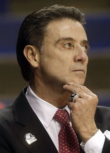 Louisville head coach Rick Pitino watches during the first half of a second-round game in the NCAA college basketball tournament against North Carolina A&T, Thursday, March 21, 2013, in Lexington, Ky. (AP Photo/John Bazemore)