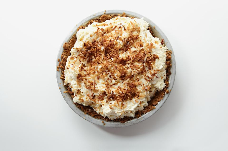 """This chilled rice pudding pie is adapted from the popular dessert at MeMe's Diner in Brooklyn, NY. A sesame-stick-crumb crust is covered in a thick layer of coconut milk caramel, then a creamy pile of of coconut rice custard and rum whipped cream. You can assemble the whole thing and chill it overnight. <a href=""""https://www.epicurious.com/recipes/food/views/rice-pudding-pie?mbid=synd_yahoo_rss"""" rel=""""nofollow noopener"""" target=""""_blank"""" data-ylk=""""slk:See recipe."""" class=""""link rapid-noclick-resp"""">See recipe.</a>"""