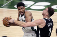 Milwaukee Bucks' Giannis Antetokounmpo drives to the basket against Brooklyn Nets' Blake Griffin during the first half of an NBA basketball game Tuesday, May 4, 2021, in Milwaukee. (AP Photo/Aaron Gash)