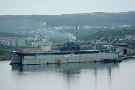 FILE PHOTO: A view shows the Russian aircraft carrier Admiral Kuznetsov at a shipyard in the town of Roslyakovo near Murmansk, Russia June 19, 2006. REUTERS/Sergei Karpukhin/File Photo