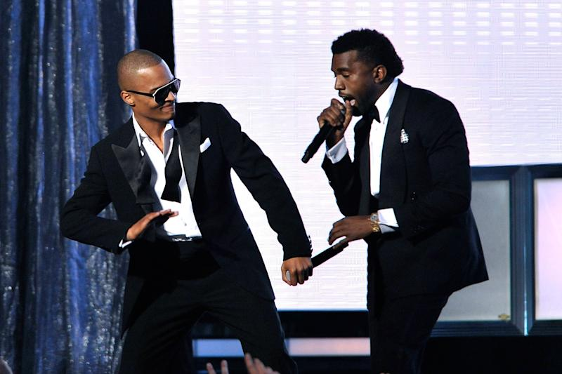 T.I. and Kanye West performing on stage