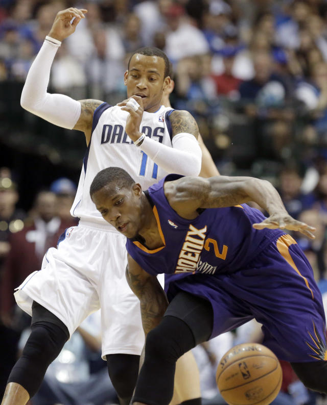 Phoenix Suns guard Eric Bledsoe (2) steals the ball from Dallas Mavericks guard Monta Ellis (11) during the first half of an NBA basketball game on Saturday, April 12, 2014, in Dallas. (AP Photo/LM Otero)