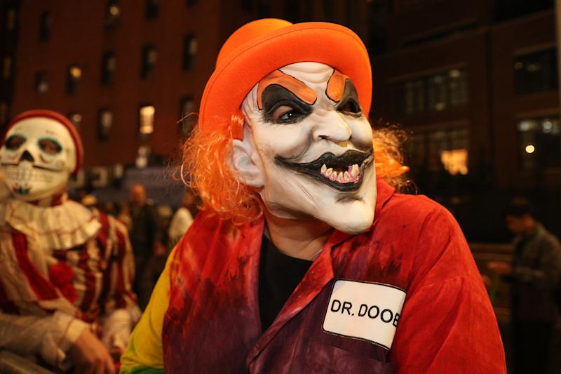A reveler dressed as a killer clown marches in the Halloween Parade in New York. (Photo: Gordon Donovan/Yahoo News)