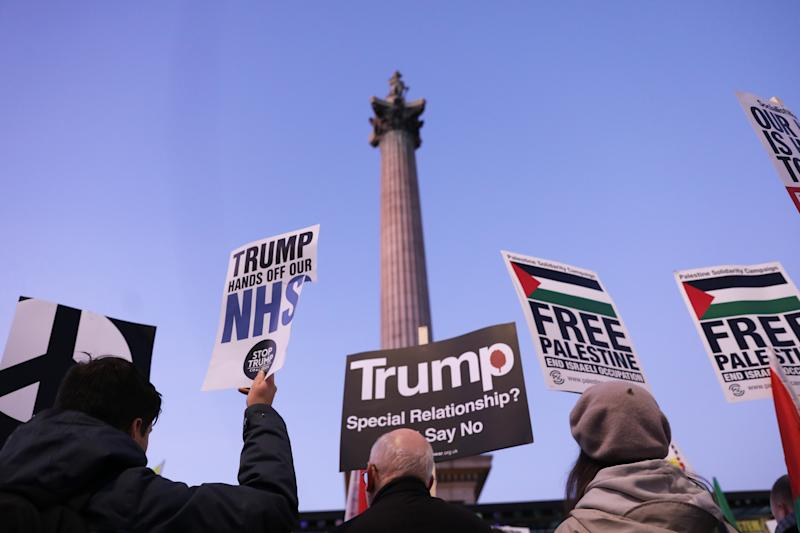 "People gather in Trafalgar Square, London, for a ""Hands off our NHS"" protest against Donald Trump, who is in the capital as Nato leaders gather to mark 70 years of the alliance."