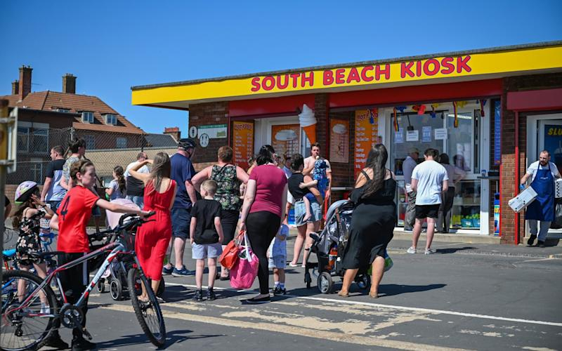 There was little sign of physical distancing in Troon on Sunday - Jeff J Mitchell/Getty