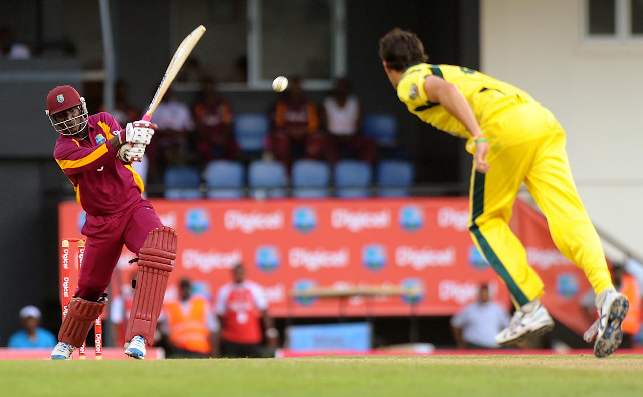 West Indies cricketer Darren Sammy plays a shot during the fifth-of-five One Day International (ODI) matches between West Indies and Australia at the Beausejour Cricket Ground in Gros Islet, St. Lucia on March 25, 2012.     AFP PHOTO/Jim Watson (Photo credit should read JIM WATSON/AFP/Getty Images)