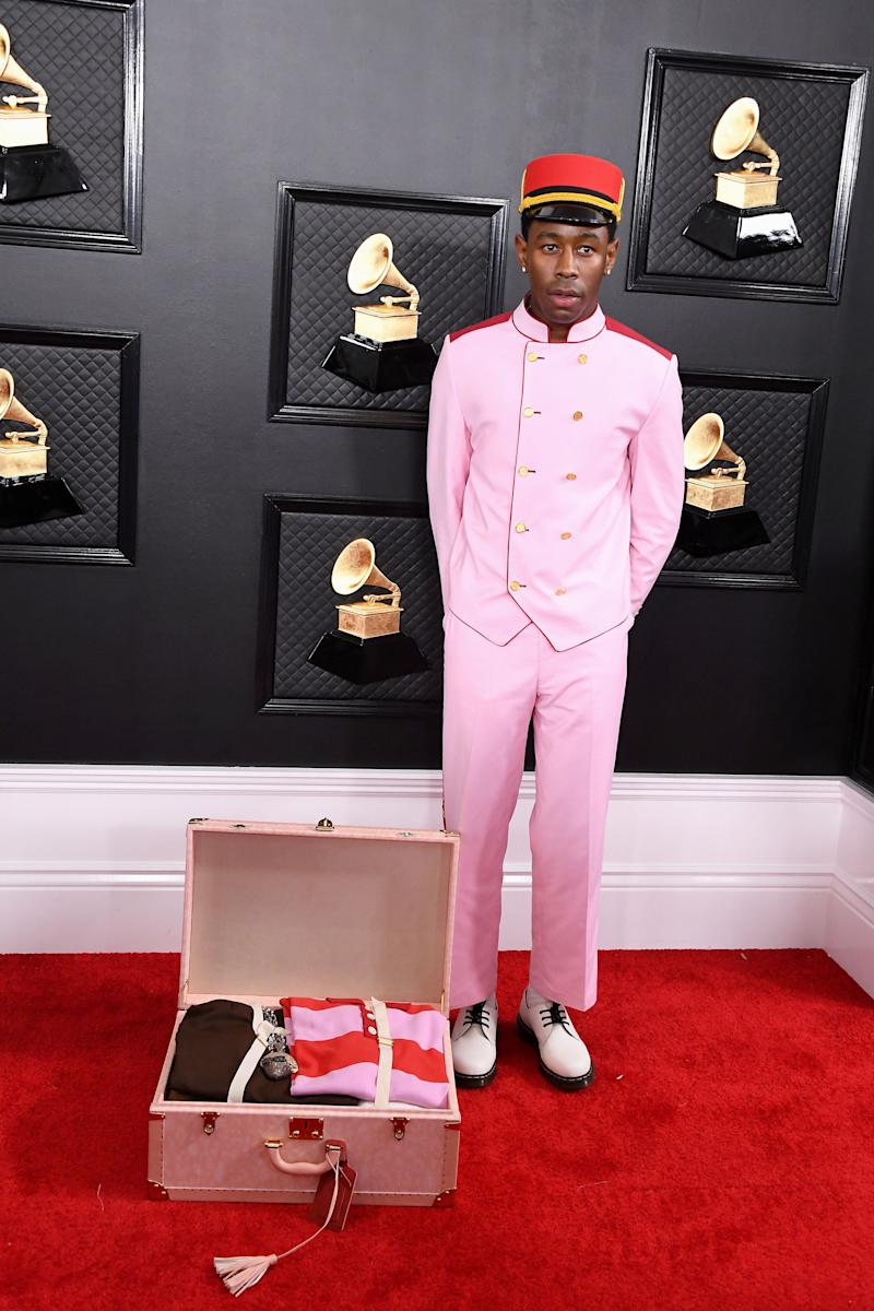 Tyler, the Creator wore a millennial pink bellhop outfit, complete with a suitcase, for some reason.