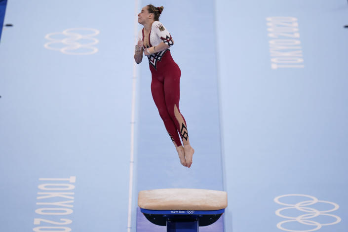 Sarah Voss, of Germany, performs on the vault during the women's artistic gymnastic qualifications at the 2020 Summer Olympics, Sunday, July 25, 2021, in Tokyo. (AP Photo/Gregory Bull)