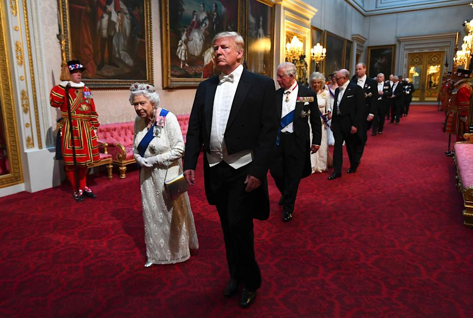 Britain's Queen Elizabeth II, centre left and US President Donald Trump and guests arrive through the East Gallery ahead of the State Banquet at Buckingham Palace in London, June 3, 2019. Trump is on a three-day state visit to Britain. (Photo: Victoria Jones/Pool Photo via AP)