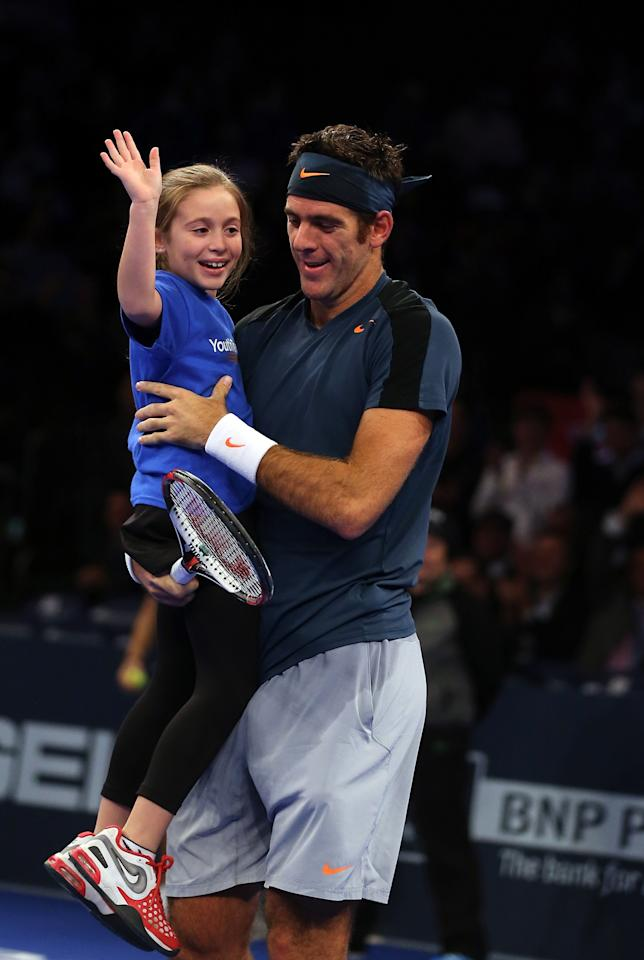NEW YORK, NY - MARCH 04:  Juan del Potro of Argentina celebrates with a fan from the stands after winning a point over the impromptu doubles team of Rafael Nadal of Spain and actor Ben Stiller during the BNP Paribas Showdown on March 4, 2013 at Madison Square Garden in New York City.  (Photo by Elsa/Getty Images)