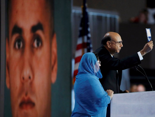 Khizr Khan, who's son Humayun (L) was killed serving in the U.S. Army, challenges Republican presidential nominee Donald Trump to read his copy of the U.S. Constitution, at the Democratic National Convention in Philadelphia, Pennsylvania, U.S. July 28, 2016. REUTERS/Lucy Nicholson