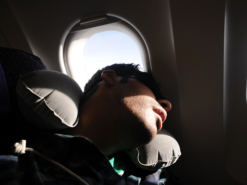 Guy sleeping in plane window seat