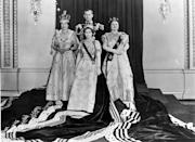 <p>Queen Elizabeth II ascended the throne the year after her father, King George VI, passed away. Here, she's pictured on her coronation day with Prince Philip, Princess Margaret, and Elizabeth the Queen Mother, dressed in full regalia, at Buckingham Palace after the ceremony.</p>