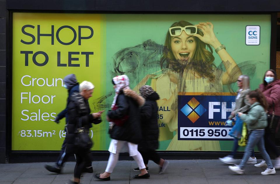 Shoppers walk past a closed down shop in Nottingham (Tim Goode/PA) (PA Wire)