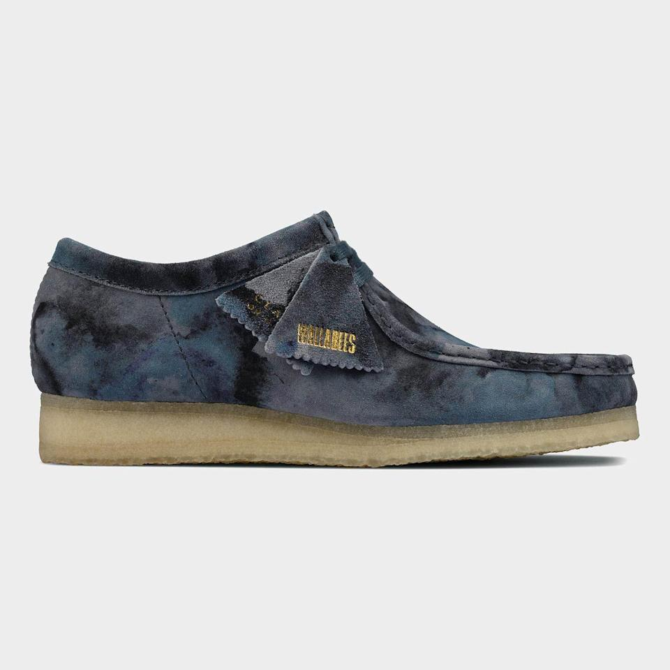 """<p><strong>Clarks</strong></p><p>toddsnyder.com</p><p><strong>$190.00</strong></p><p><a href=""""https://go.redirectingat.com?id=74968X1596630&url=https%3A%2F%2Fwww.toddsnyder.com%2Fcollections%2Fnew-arrivals%2Fproducts%2Fclarks-wallabee-blue-camo-blue&sref=https%3A%2F%2Fwww.esquire.com%2Fstyle%2Fmens-fashion%2Fg36147610%2Fbest-new-menswear-april-16-2021%2F"""" rel=""""nofollow noopener"""" target=""""_blank"""" data-ylk=""""slk:Shop Now"""" class=""""link rapid-noclick-resp"""">Shop Now</a></p><p>Is it really a camo? Maybe a tie-dye? Why not both?!</p>"""