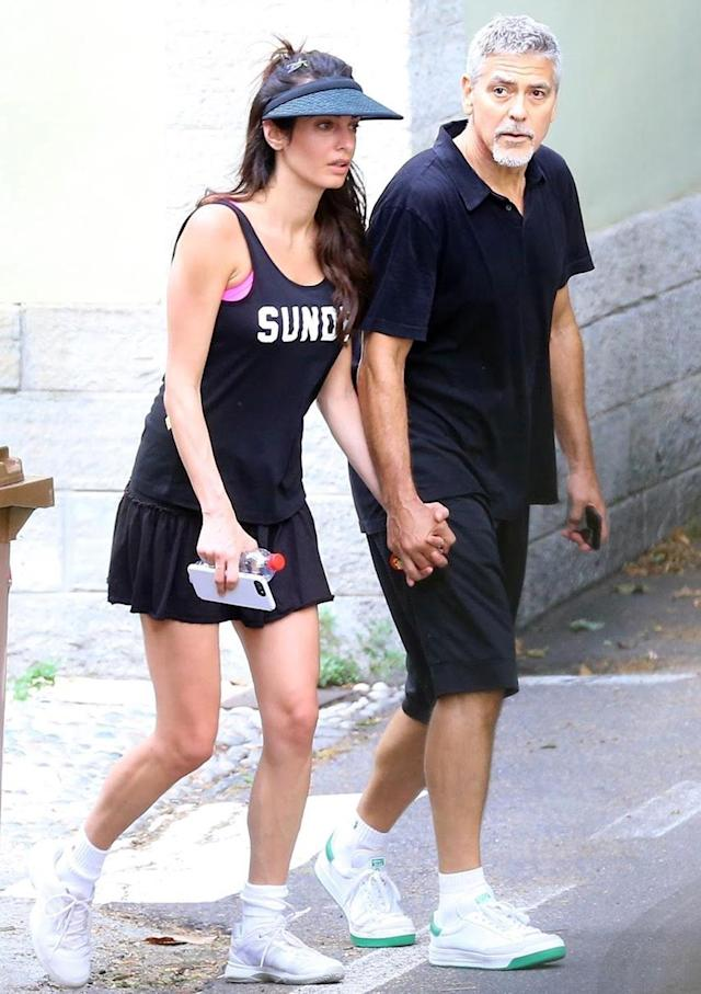 Amal Clooney and George Clooney sport matching tennis outfits in Laglio, Italy. (Photo: BACKGRID)