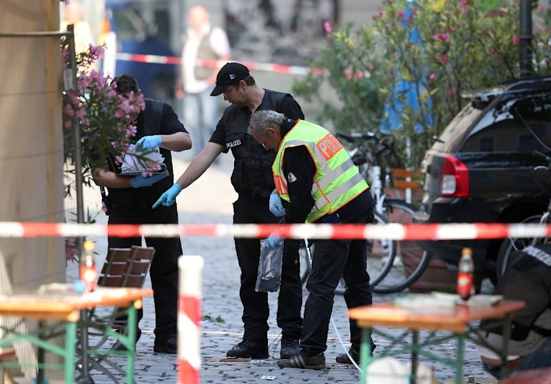 German police inspect the site of a suicide bombing in Ansbach, on July 25, 2016