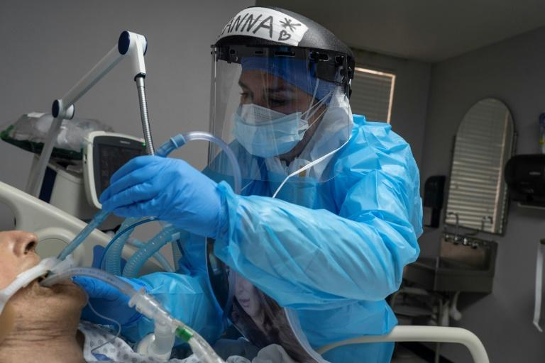 Medical staff treats a patient suffering from coronavirus in intensive care at the United Memorial Medical Center in Houston on November 10, 2020