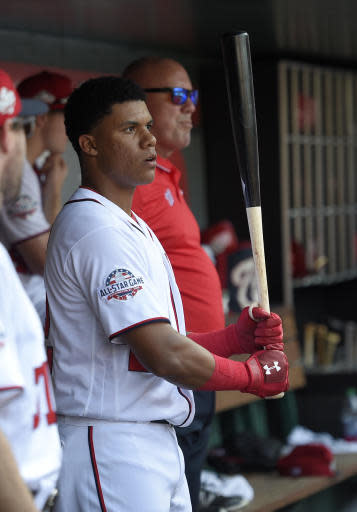 Washington Nationals' Juan Soto stands in the dugout during a baseball game against the Los Angeles Dodgers, Sunday, May 20, 2018, in Washington. (AP Photo/Nick Wass)