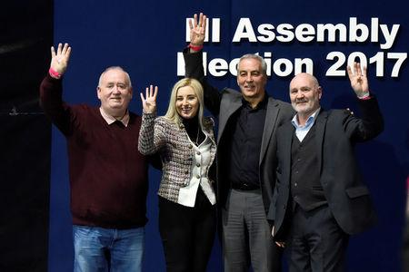 Sinn Fein elected candidates for East Belfast Fran McCann, Orlaithi Flynn, Pat Sheehan and Alex Maskey pose on stage at the count centre in Belfast