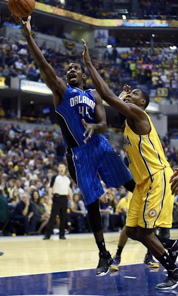 Orlando Magic forward Andrew Nicholson, left, releases a shot next to Indiana Pacers center Roy Hibbert in the first half of an NBA basketball game in Indianapolis, Tuesday, Oct. 29, 2013. (AP Photo/R Brent Smith)