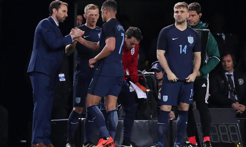 The England manager, Gareth Southgate, congratulates Jake Livermore as he is substituted for James Ward-Prowse during the international friendly against Germany.