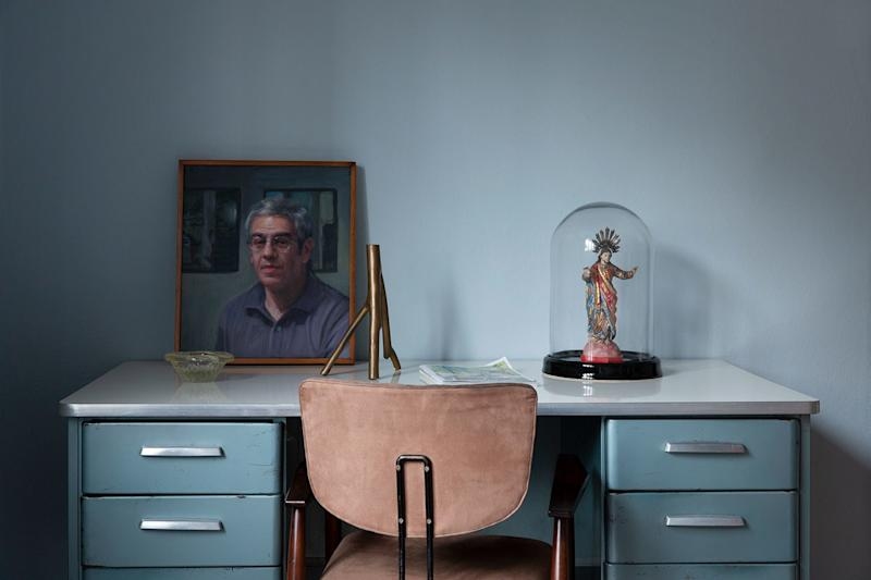 "On the vintage metal desk is a portrait of the homeowner painted by Rodrigo Cunha. ""I bought the candlestick at an Ines de La Fressange boutique in Paris and the chair is by Michel Arnoult."""