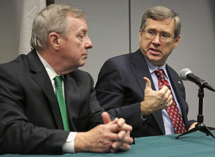 FILE - In this Nov. 25, 2013 file photo, U.S. Senators Dick Durbin, D-Ill., left, and Mark Kirk, R-Ill., speak at a joint news conference in Chicago. Both Durbin and Kirk have proposed naming the Bureau of Alcohol, Tobacco, Firearms and Explosives in Washington after Prohibition-era crime fighter Eliot Ness, but a prominent Chicago alderman and others point to evidence that Ness' role in the demise of Chicago mobster Al Capone was as mythical as Mrs. O'Leary's cow starting the Great Chicago Fire and are trying to convince the senators to drop the whole thing. The senators are not backing down, though, insisting he deserves it anyway. (AP Photo/M. Spencer Green, File)