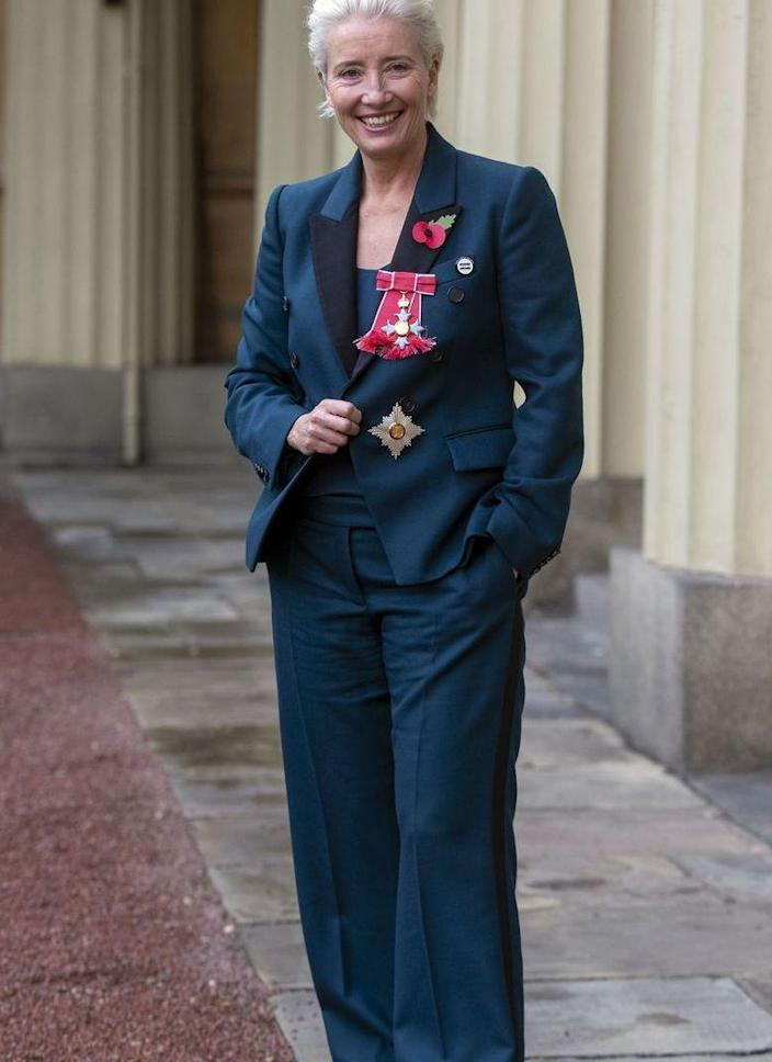 <p>Emma Thompson isn't about to change her style just because she's heading to the palace. The always-cool actress rocked white sneakers with her navy suit set to receive her damehood honor at Buckingham Palace. </p>