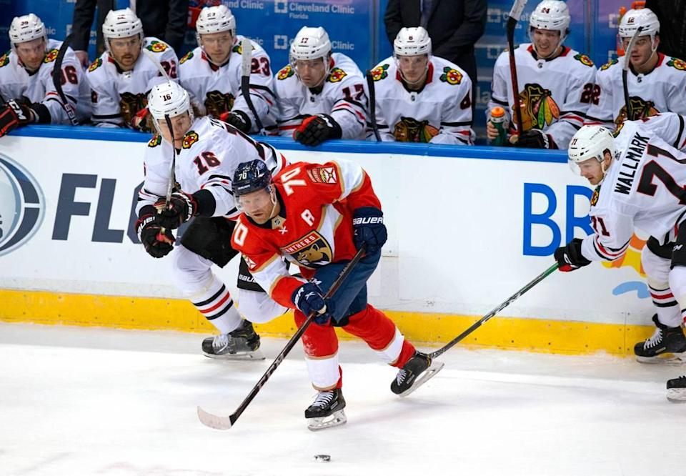Florida Panthers right wing Patric Hornqvist (70) go for the puck against Chicago Blackhawks defenseman Nikita Zadorov (16) and Lucas Wallmark (71) during the first period of the Florida Panthers NHL home opener game at the BB&T Center on Sunday, January 17, 2021 in Sunrise, Fl.