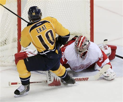 Detroit Red Wings goalie Jimmy Howard (35) makes a stop on a shot by Nashville Predators left wing Martin Erat (10), of the Czech Republic, in the second period of an NHL hockey game Monday, Dec. 26, 2011, in Nashville, Tenn. (AP Photo/Mark Humphrey)