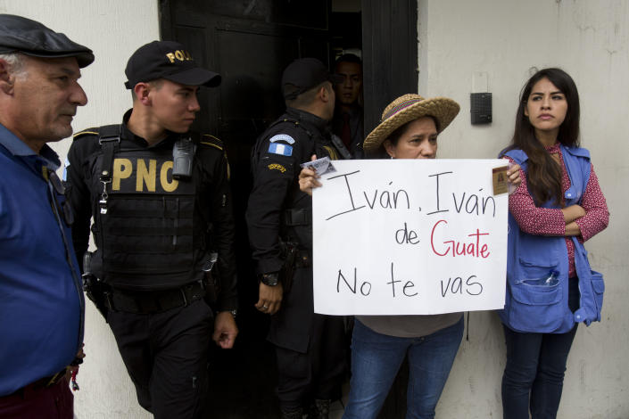 Supporters of Commissioner Ivan Velasquez hold a sign in front of the United Nations International Commission Against Impunity, CICIG, headquarters in Guatemala City, Friday, Aug. 31, 2018. Guatemala president Jimmy Morales says he is not renewing mandate of U.N.-sponsored commission investigating corruption in the country. (AP Photo/Moises Castillo)