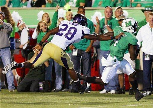 Marshall receiver Demetrius Evans scores a touchdown against Western Carolina's Ace Clark during an NCAA college football game on Saturday, Sept. 8, 2012, at Joan C. Edwards Stadium in Huntington, W.Va. (AP Photo/The Herald-Dispatch, Mark Webb)