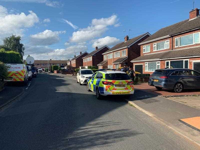 Police at the scene in Cairndhu Drive in Kidderminster, as an investigation has been launched after a serving police officer and child were found dead.