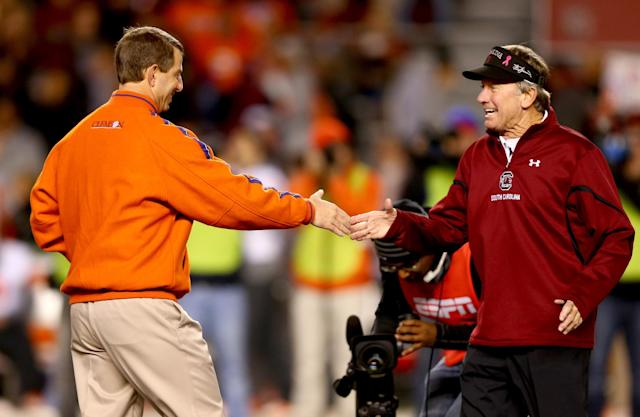 COLUMBIA, SC - NOVEMBER 30: (L-R) Head coach Dabo Swinney of the Clemson Tigers talks to head coach Steve Spurrier of the South Carolina Gamecocks before their game at Williams-Brice Stadium on November 30, 2013 in Columbia, South Carolina. (Photo by Streeter Lecka/Getty Images)