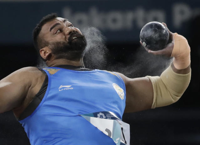 India's Tajinderpal Singh Toor throw's in the men's shot put final during the athletics competition at the 18th Asian Games in Jakarta, Indonesia, Saturday, Aug. 25, 2018. (AP Photo/Lee Jin-man)
