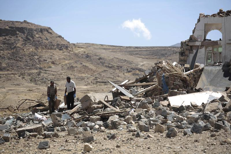 Forensic experts inspect the rubble of a house destroyed by a Saudi-led airstrikes in outskirts of Sanaa, Yemen, Thursday, Feb. 16, 2017. At least one Saudi-led airstrike near Yemen's rebel-held capital killed at least five people on Wednesday, the country's Houthi rebels and medical officials said. (AP Photo/Hani Mohammed)