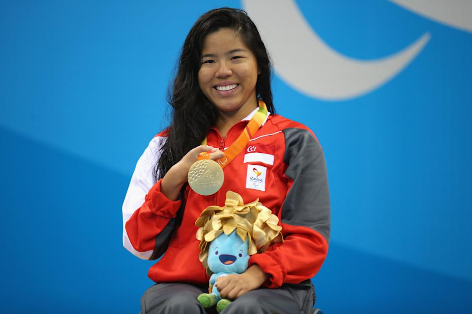Yip Pin Xiu with her gold medal in the women's 100m backstroke at the 2016 Rio de Janeiro Paralympics.