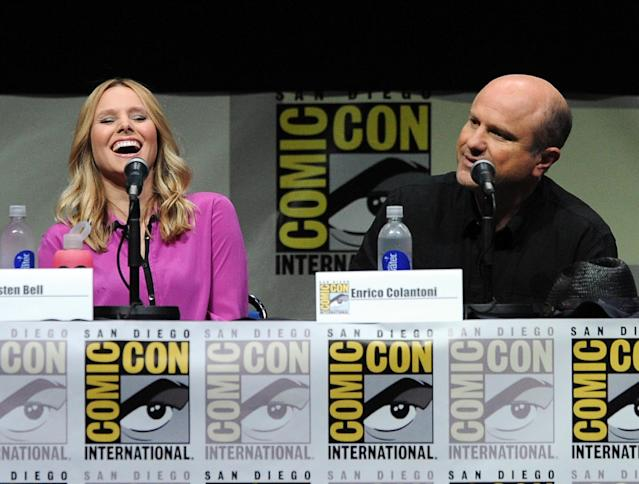 "SAN DIEGO, CA - JULY 19: Actress Kristen Bell (L) and actor Enrico Colantoni speak onstage at the ""Veronica Mars"" special video presentation and Q&A during Comic-Con International 2013 at San Diego Convention Center on July 19, 2013 in San Diego, California. (Photo by Kevin Winter/Getty Images)"