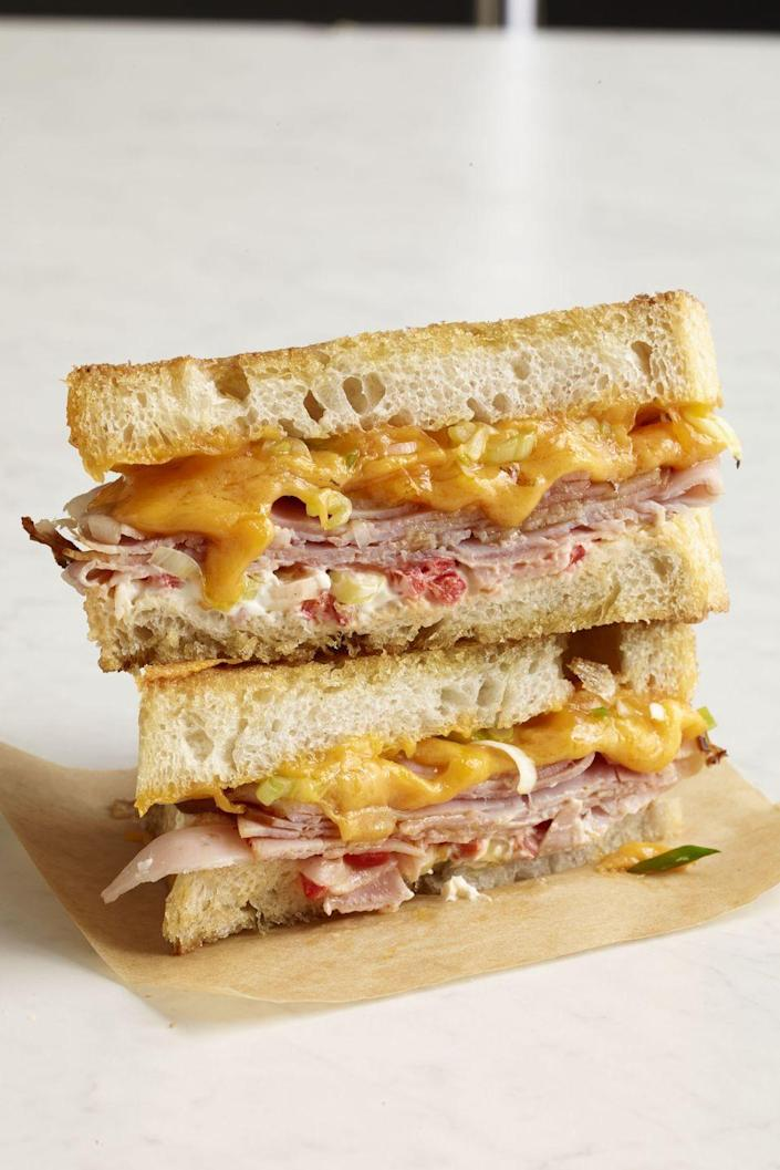 """<p>Looking for a southern-inspired spin on a grilled cheese? This pimiento-stuffed version is it. </p><p><a href=""""https://www.womansday.com/food-recipes/food-drinks/recipes/a12240/ham-pimiento-grilled-cheese-recipe-wdy1013/"""" rel=""""nofollow noopener"""" target=""""_blank"""" data-ylk=""""slk:Get the recipe for Ham and Pimiento Grilled Cheese."""" class=""""link rapid-noclick-resp""""><strong><em>Get the recipe for Ham and Pimiento Grilled Cheese. </em></strong></a></p>"""