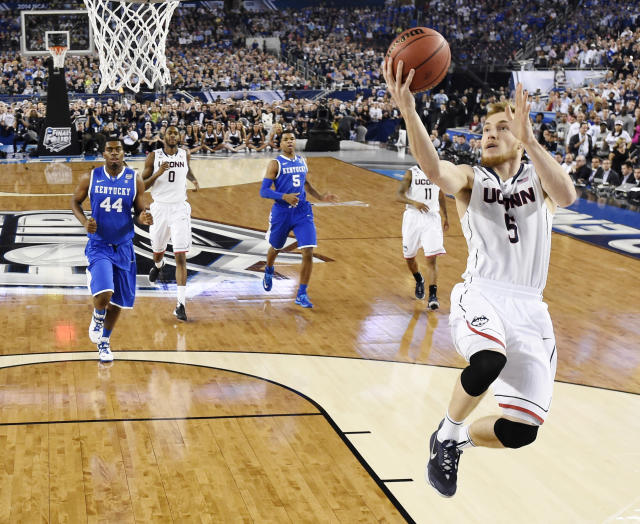 Niels Giffey (5) shoots the ball against Kentucky during the first half of the NCAA Final Four tournament college basketball championship game Monday, April 7, 2014, in Arlington, Texas. (AP Photo/Chris Steppig, pool)