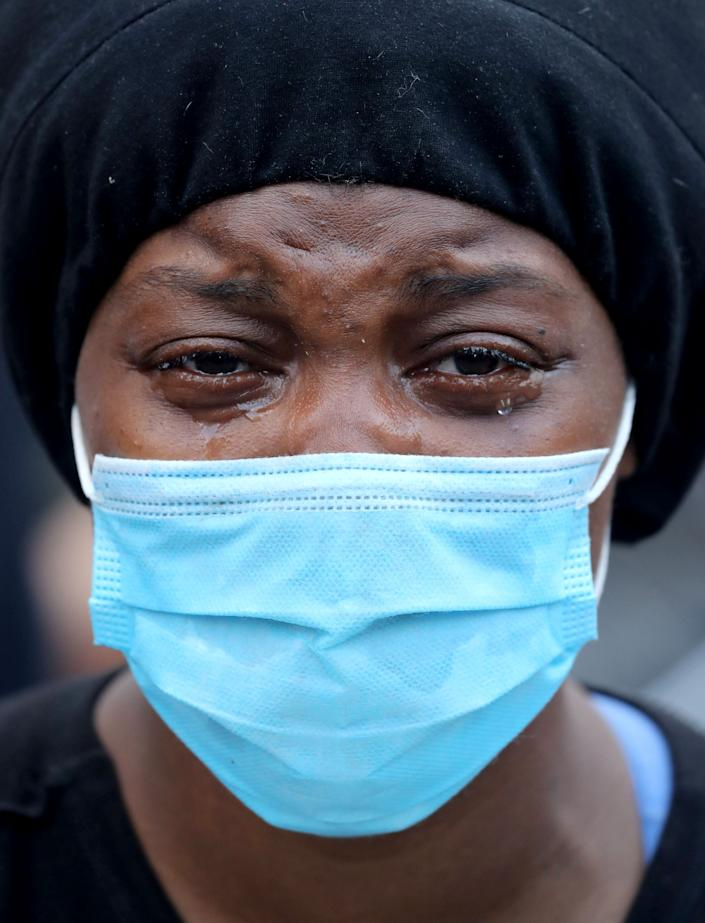A woman cries as she joins protesters at Union Square in Manhattan on Saturday.