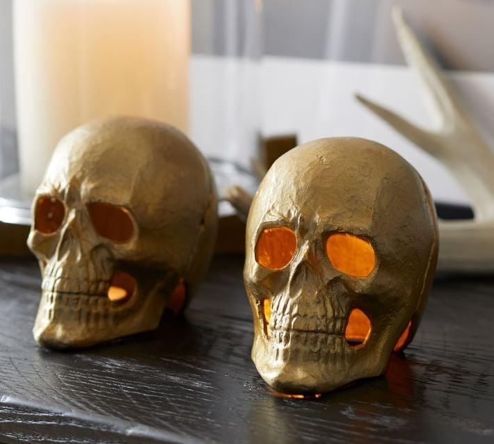 <p>Guests will jump (out of fright) when they see this <span>Brass Skull Votive Candle Holder</span> ($25).</p>