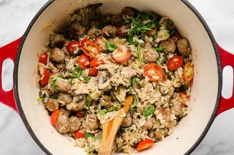 """<p>Transform a plain pot of rice into a delicious new weeknight dinner. This Mediterranean-inspired version has sausage, fennel, mushrooms, and cherry tomatoes. </p><p><a href=""""https://www.thepioneerwoman.com/food-cooking/recipes/a94658/one-pot-sausage-and-veggie-rice/"""" rel=""""nofollow noopener"""" target=""""_blank"""" data-ylk=""""slk:Get the recipe."""" class=""""link rapid-noclick-resp""""><strong>Get the recipe. </strong></a></p><p><a class=""""link rapid-noclick-resp"""" href=""""https://go.redirectingat.com?id=74968X1596630&url=https%3A%2F%2Fwww.walmart.com%2Fsearch%2F%3Fquery%3Ddutch%2Boven&sref=https%3A%2F%2Fwww.thepioneerwoman.com%2Ffood-cooking%2Fmeals-menus%2Fg37078352%2Fitalian-sausage-recipes%2F"""" rel=""""nofollow noopener"""" target=""""_blank"""" data-ylk=""""slk:SHOP DUTCH OVENS"""">SHOP DUTCH OVENS</a></p>"""