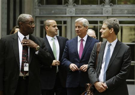 J.P. Morgan CEO Jamie Dimon (2nd R) leaves the U.S. Justice Department after meeting with Attorney General Eric Holder, in Washington September 26, 2013. REUTERS/Gary Cameron